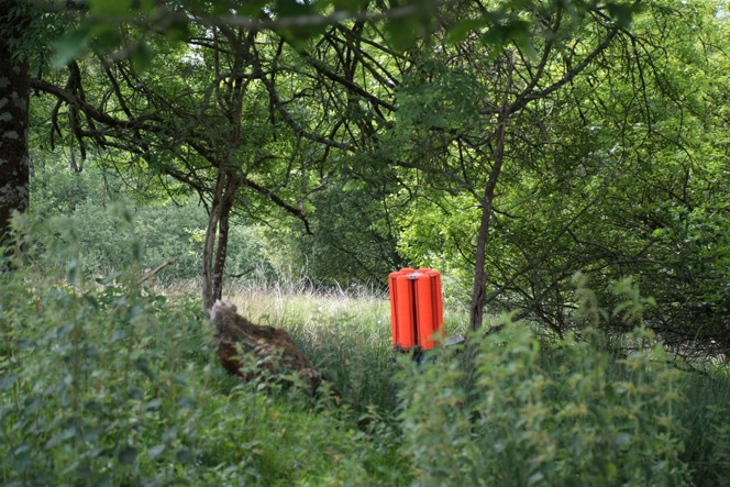 Bright coloured clay shooting traps stand out amongst the countryside.